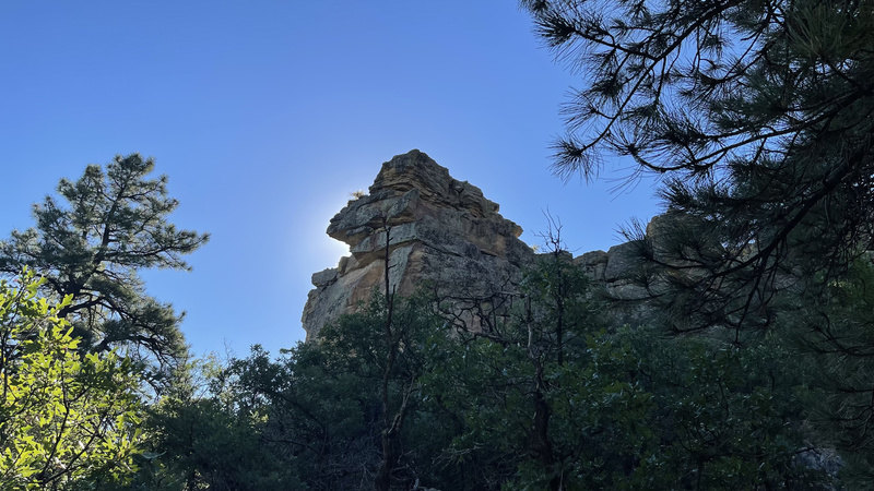 outcropping with the sun behind it