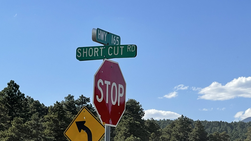 Stop sign at the junction of Highway 165 and Short Cut Road
